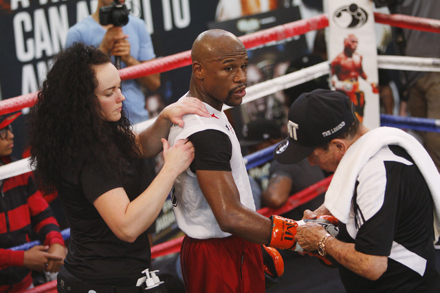 Boxer Floyd Mayweather Jr., middle, gets ready to spar in front of the media in preparation for his upcoming fight against Marcos Maidana at his gym in Las Vegas on April 22, 2014. (Jason Bean/Las ...