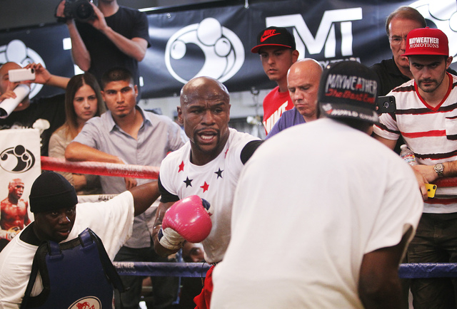Boxer Floyd Mayweather Jr., middle, works out in front of the media in preparation for his upcoming fight against Marcos Maidana at his gym in Las Vegas on April 22, 2014. (Jason Bean/Las Vegas Re ...