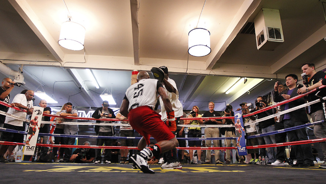 Boxer Floyd Mayweather Jr. ducks while sparring in front of the media in preparation for his upcoming fight against Marcos Maidana at his gym in Las Vegas on April 22, 2014. (Jason Bean/Las Vegas  ...