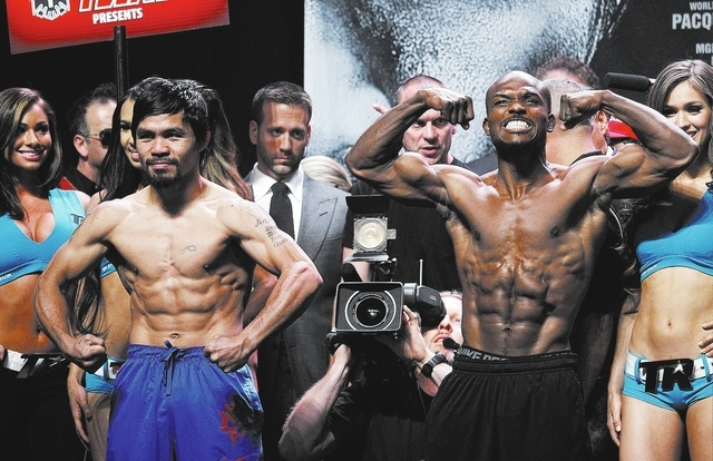 Boxers Manny Pacquiao, left, and Timothy Bradley pose after getting weighed in prior to their rematch at the MGM Grand Garden Arena in Las Vegas on April 11, 2014. (Jason Bean/Las Vegas Review-Jou ...