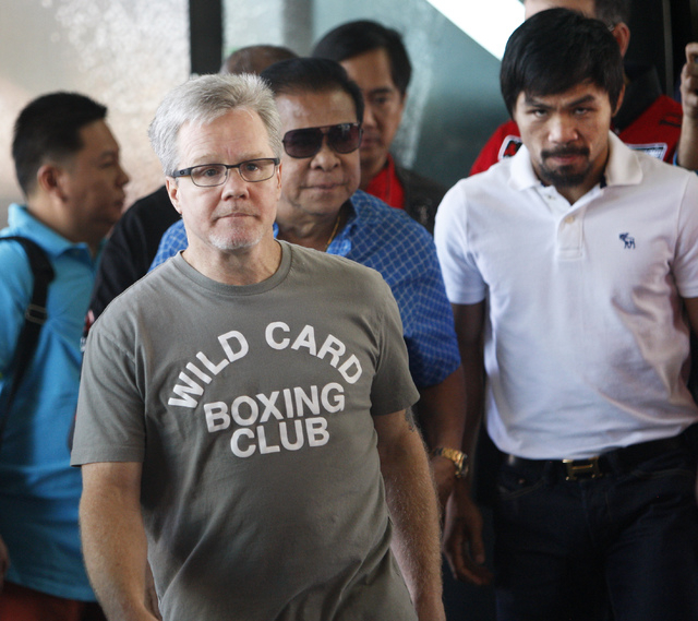 Boxer Manny Pacquiao, right, and his trainer Freddie Roach, left, arrive at the MGM Grand in Las Vegas on April 8, 2014. (Jason Bean/Las Vegas Review-Journal)