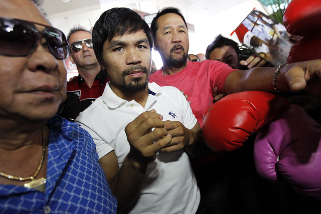Boxer Manny Pacquiao, middle, arrives at the MGM Grand in preparation for his rematch against Timothy Bradley in Las Vegas on April 8, 2014. (Jason Bean/Las Vegas Review-Journal)