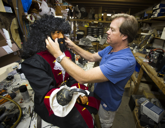Olaf Stanton, owner of Characters Unlimited in Boulder City, works on a refurbished pirate in his workshop April 1. He built the character back in 1992. The company makes hundreds of life-sized ch ...