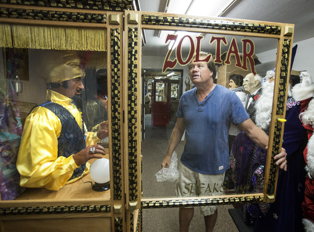 Olaf Stanton, owner of Characters Unlimited in Boulder City, inspects a  Zoltar fortune-telling machine. (Jeff Scheid/Las Vegas Review-Journal)