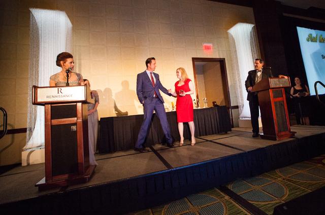 Scott Robertson, center left, with Danielle Bisterfeldt of Summerlin and The Howard Hughes Corporation, accept the award for best advertising. (Chase Stevens/Las Vegas Business Press)