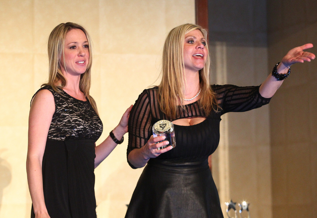 Shannon Marler, left, and Aime Sibley of Pardee Homes react while accepting the award for best kitchen 200 square feet and under during the Silver Nugget Awards. (Chase Stevens/Las Vegas Business  ...