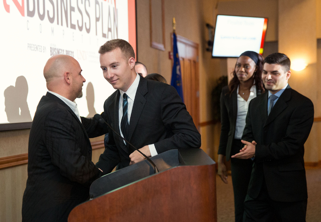 Dominic Anthony Marrocco, left, congratulates Greg Friesmuth, CEO and co-founder of Skyworks Aerial Systems, after announcing his team won the Dominic Anthony Marrocco Southern Nevada Business Pla ...