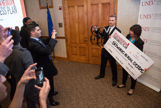 Greg Friesmuth, CEO and co-founder of Skyworks Aerial Systems, and Jinger Zeng, COO and co-founder, pose for photos after winning the Dominic Anthony Marrocco Southern Nevada Business Plan Competi ...