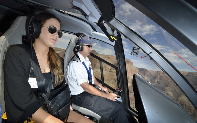 Passenger Sophie Balkin, left, is shown with pilot Chris Densmore as he dips into the Grand Canyon for a Sundance Helicopters champagne lunch on April 11. (Bill Hughes/Las Vegas Review-Journal)