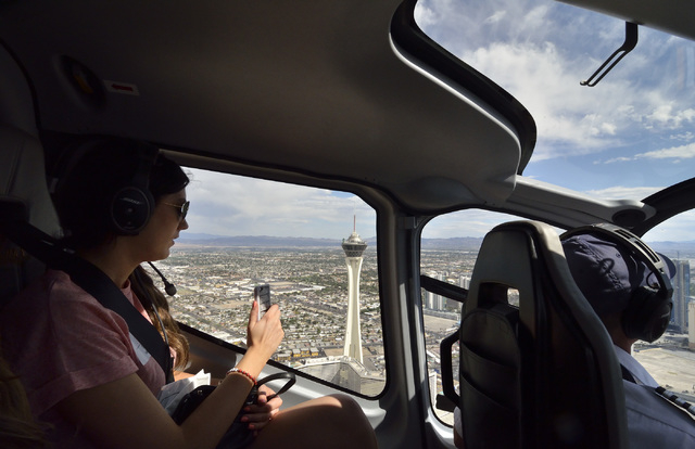 Passenger Kate Balkin is shown flying over Las Vegas on the return trip from a Sundance Helicopters champagne lunch. (Bill Hughes/Las Vegas Review-Journal)