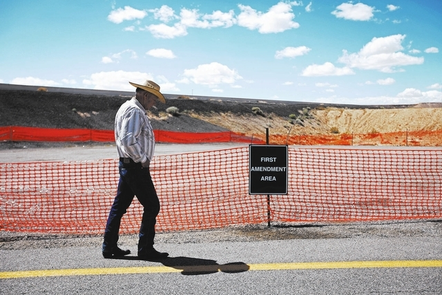 Cliven Bundy walks by a first amendment area set up by the Bureau of Land Management near Bunkerville, Nev. Tuesday, April 1, 2014. The Bureau of Land Management has been closing off the Gold Butt ...