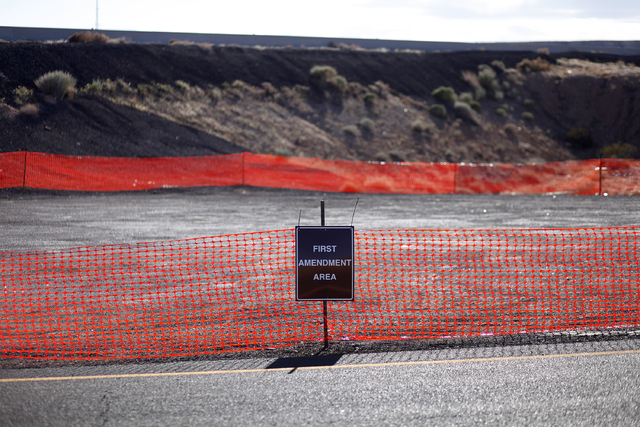 "A sign marks a ""first amendment area"" to designate where protesters can protest near Bunkerville, Nev. Tuesday, April 1, 2014. The Bureau of Land Management has been closing off the Gold ..."