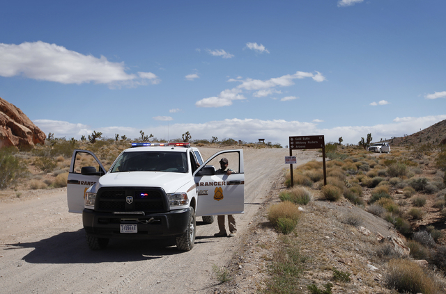 Bureau of Land Management rangers block a road 80 miles northeast of Las Vegas Tuesday, April 1, 2014. The Bureau of Land Management has been closing off the Gold Butte area near Bunkerville, Nev. ...