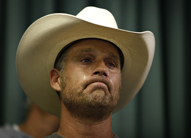 Tyson Houston, nephew of Cliven Bundy, cries after speaking at a public meeting in the Moapa Valley Community Center in Overton, Nev. Wednesday, April 9, 2014. The meeting was about the roundup by ...