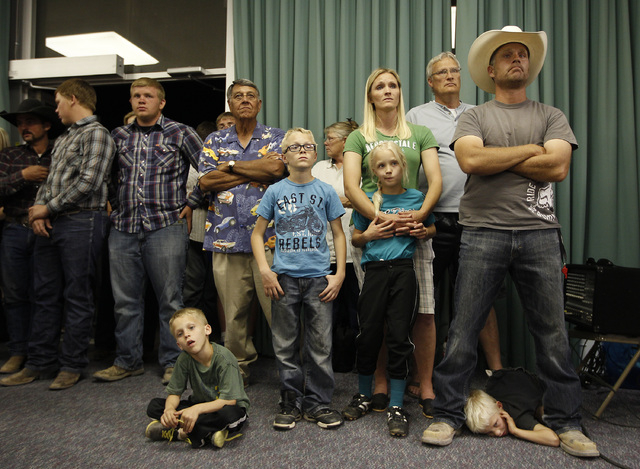 A crowd of people spill out the door at a public meeting in the Moapa Valley Community Center in Overton, Nev. Wednesday, April 9, 2014. The meeting was about the roundup by the Bureau of Land Man ...