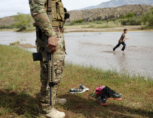 Anthony Scalzo stands by the Virgin River during a rally in support of Cliven Bundy near Bunkerville, Nev. Friday, April 18, 2014. (John Locher/Las Vegas Review-Journal)