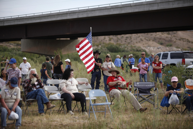 People gather along the Virgin River during a rally in support of Cliven Bundy near Bunkerville on Friday, April 18, 2014. (John Locher/Las Vegas Review-Journal)