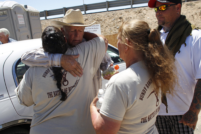 Rancher Cliven Bundy, second from left, hugs a supporter before holding a press conference near Bunkerville, Nev. Thursday, April 24, 2014. (John Locher/Las Vegas Review-Journal)