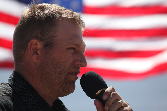Ammon Bundy welcomes people to a testimonial ceremony near his father Cliven Bundy's ranch in Bunkerville on Sunday, April 13, 2014. Cliven Bundy and the Bureau of Land Management reached a deal t ...