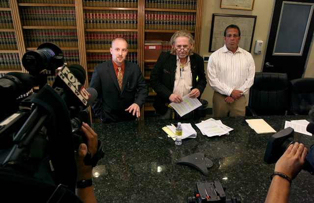 Left to right: Mitchell Bisson, Matthew Callister and Stephen Immerman address the media at Callister's law office in downtown Las Vegas on Wednesday, April 23, 2014. Callister received an anonymo ...