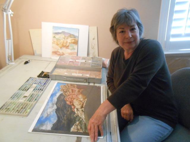 Linda Campbell pauses April 1 from working on one of the pieces she was inspired to create at Red Rock Canyon. An art exhibit planned for summer featuring work from all three artists-in-residence. ...