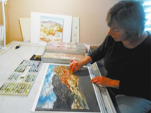 Linda Campbell works at her drafting table April 1 using one of the pieces she began at Red Rock Canyon National Conservation Area. She left a career of interior designing in Los Angeles to move t ...