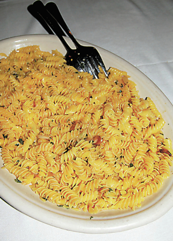 Garlic and oil pasta at Carmine's, the Forum Shops at Caesars: Sauce infused with fresh, roasted garlic is finished with Romano cheese and breadcrumbs and served over your choice of pasta, which ...