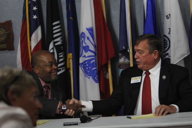 Republican Congressional District 4 candidates Niger Innis, left, and Cresent Hardy shake hands after debating at the Mesquite Veteran's Center on April 3, 2014. (Jason Bean/Las Vegas Review-Journal)