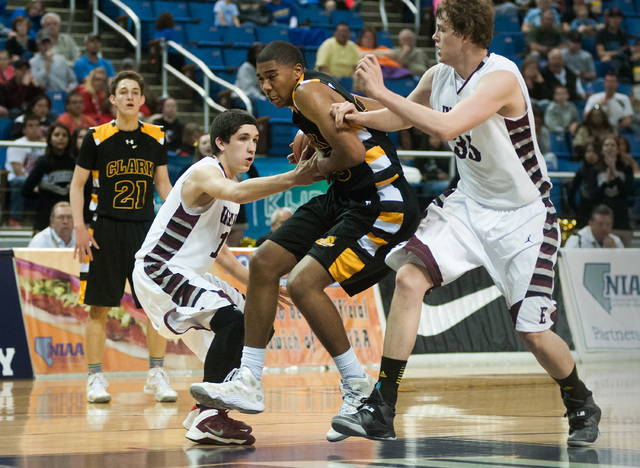 Clark's Sherron Wilson (35) tries to break through Elko's Eric Klekas (13) and Brian Pearson (35) during the Division I -A state title game. The senior small forward, who averaged 12.1 points and  ...
