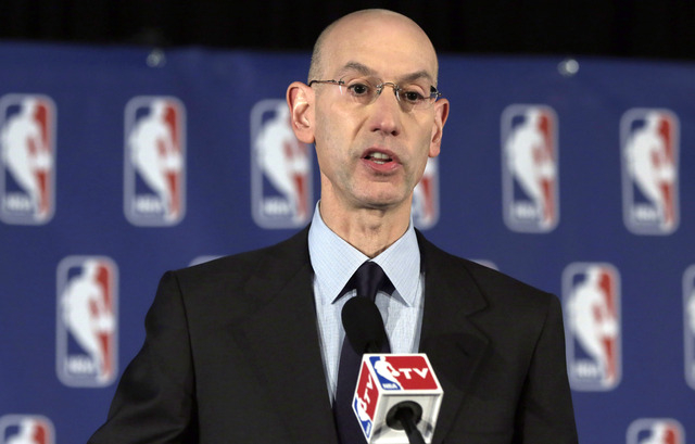 NBA Commissioner Adam Silver reads a statement during a news conference, in New York, Tuesday, April 29, 2014. Silver announced that he is banning Los Angeles Clipper owner Donald Sterling for lif ...