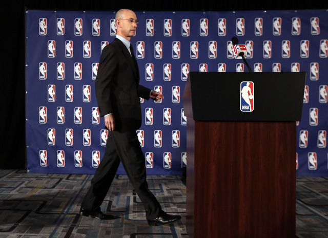 NBA Commissioner Adam Silver walks to the podium at news conference in New York, Tuesday, April 29, 2014.  Silver announced that he is banning Los Angeles Clipper owner Donald Sterling for life fr ...