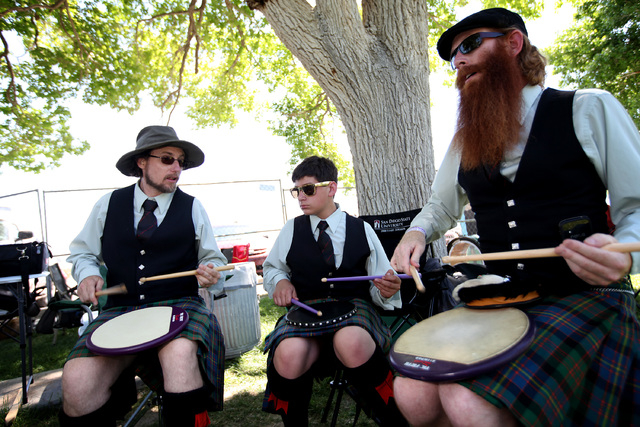From left, Ryan Burdick, Pierce Rose and Aaron Mars, all of San Diego, Calif., practice for the drum band competition at the Las Vegas Celtic Gathering and Highland Games at Floyd Lamb Park on Apr ...
