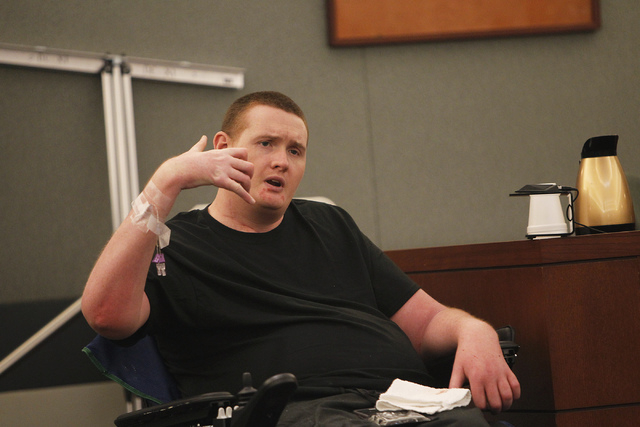Kevin Cooney testifies as to where he thought the gun was when he was shot in the neck during the attempted murder trial of his mother Linda Cooney at the Clark County Regional Justice Center in L ...