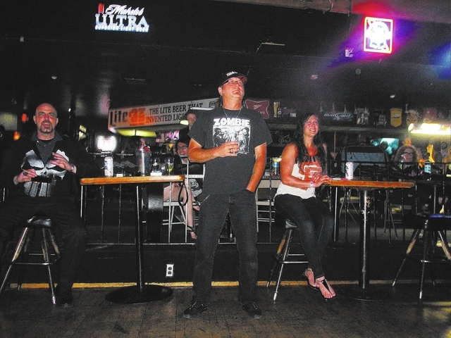 Organizer of the event Justin Pimentel, center, watches a band perform during the Liberation Through Music & Art event held at The Cheyenne Saloon, 3103 N. Rancho Drive in Las Vegas, April 5, 2014 ...