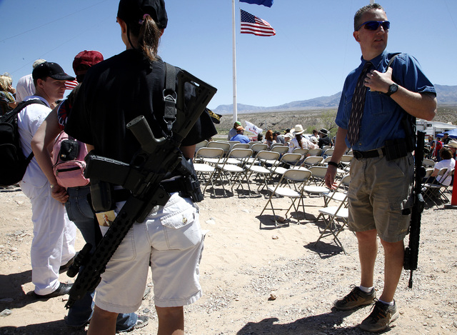 John Jamison, right, of Mesquite, waits for the beginning of a press conference at the protest camp near Cliven Bundy's ranch in Bunkerville on Monday, April 14, 2014. Jamison was out of town but  ...
