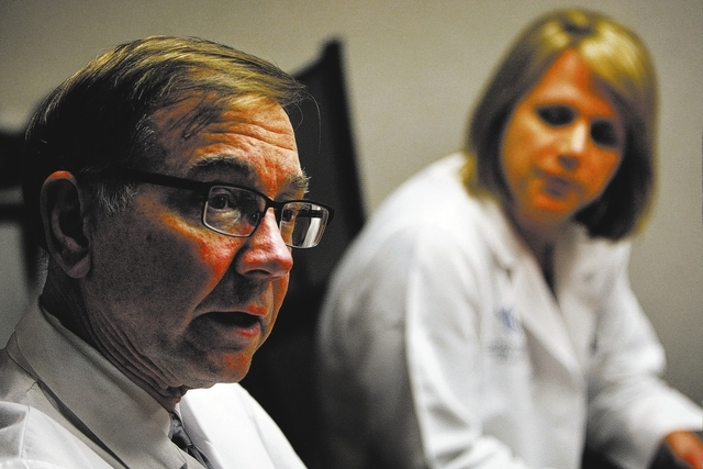 Medical Oncologist Dr. Nicholas Vogelzang, left, leads the staff at the Comprehensive Cancer Centers of Nevada in a round table discussion in Las Vegas on Feb. 4, 2014. Dr. Regan Holdridge is seen ...