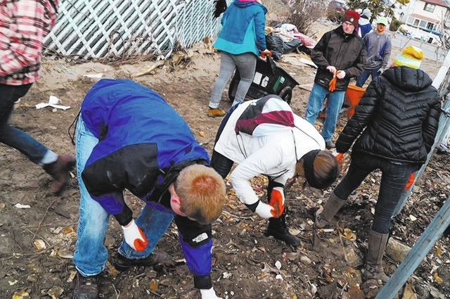 Frank Garrison, left, and student volunteers from the University of Redlands in California spent their 2013 spring break volunteering in Breezy Point, New York helping victims of Hurricane Sandy,  ...