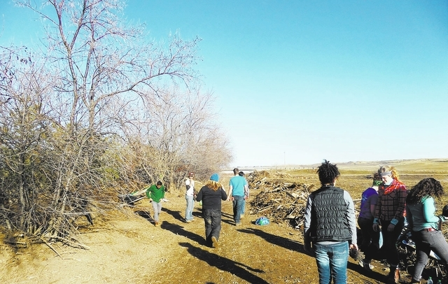 Frank Garrison and 25 other students spent their 2014 spring break in Boulder, Colorado to help families affected by the September 2013 floods that destroyed more than 1,500 homes, March 2014. (Sp ...