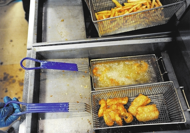 Pieces of fish are cooked during the weekly fish fry at St. Viator Catholic Church on Friday, March 28, 2014. (David Becker/Las Vegas Review-Journal)