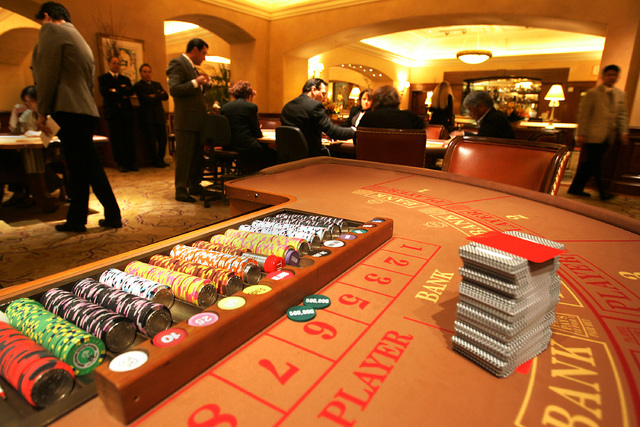 Chips and cards are shown on a baccarat table in the high-roller VIP baccarat room at the MGM Grand on April 9, 2007, in Las Vegas. Baccarat helped drive Nevada gaming revenue in 2013. (Las Vegas  ...