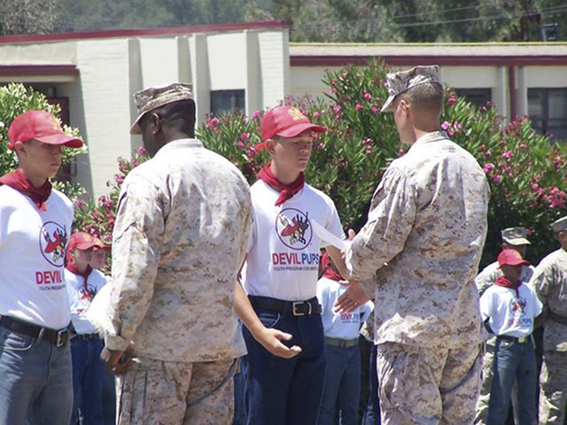 Marco Soria, left, and William Redd shake hands with Marines at the Southern Nevada Devil Pups graduation in August 2013 on the parade deck at Camp Pendleton in California. Ten of the 19 awards we ...
