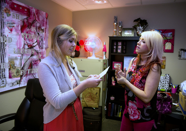 Assistant Janessa Holway, left, and Annie Lobert, founder of Hookers for Jesus, talk inside Lobert's office at Valley Bible Fellowship. (Samantha Clemens/View)