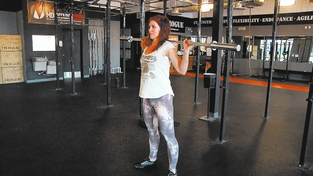 Starting position for barbell squat complex with Laura Salcedo at Cross Fit Mountain's Edge on Wednesday March 19, 2014. (Michael Quine/Las Vegas Review-Journal)