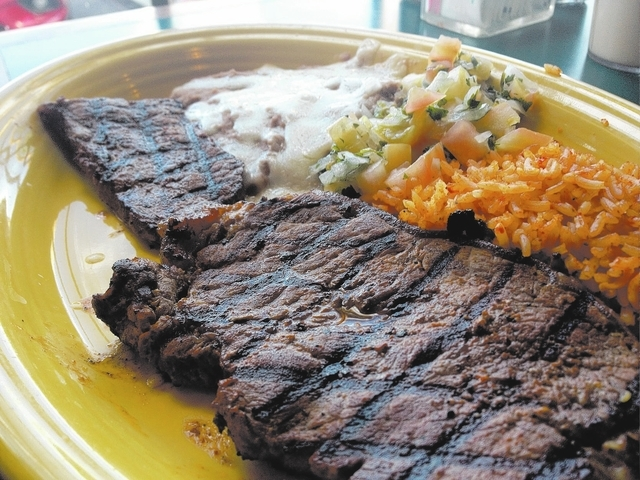 The carne asada plate is made from a marinated thin New York steak served with traditional Mexican rice and beans and a side of pico de gallo. (Sandy Lopez/View)