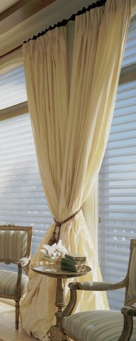 Courtesy GMJ Interiors  Drapes are usually more formal than curtains. They're floor length and lined.