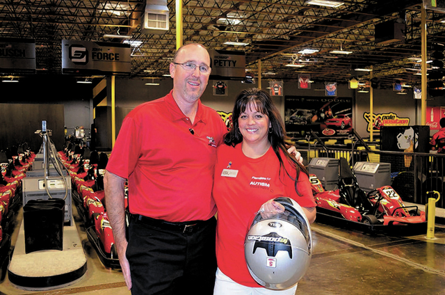 Courtesy photo Brad Mark, chief operating officer of Pole Position Raceway, and Jennifer Strobel, executive director of Families for Effective Autism Treatment, stand near the racetrack at Pole Po ...