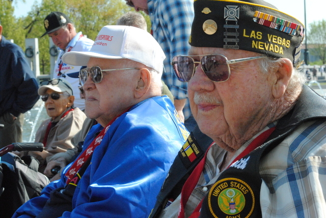 """Army veteran James Smith, 90, (on right) served in the Atlantic and Pacific theaters during World War II. He is a """"charter"""" member of the Memorial having contributed to its construction. """"It's wor ..."""