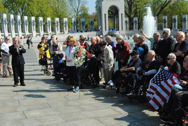 A bugler plays Taps as members of the Southern Nevada Honor Flight lay a wreath at the WWII memorial on Saturday. (Peter Urban/Stephens Washington Bureau)