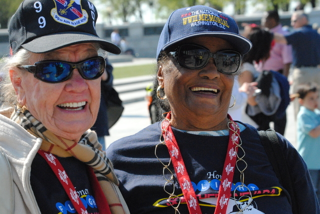Joyce Hendry (left) and Gloria Lewis (right) share a laugh at the WWII memorial. The two women, who live in Las Vegas, were Army clerks during WWII. Hendry, 88, served in London as a member of the ...