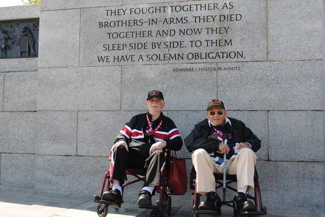 """""""Brother in Arms"""" veterans Frank Mileti (left) and Joe Vento (right) pose under a quote from Adm. Chester W. Nimitz. Mileti, 89, is a Navy veteran who served in China. Vento, 96, is an Army vetera ..."""